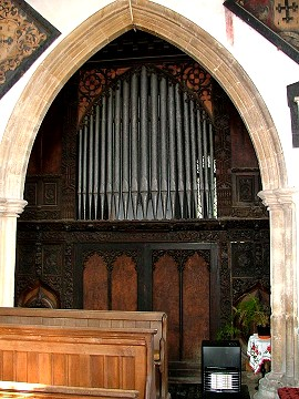 Scottow: unique organ case, built for (or by) the squire, Sir Henry Durrant 1859, incorporating old carving including what appears to be a Jacobean fireplace.